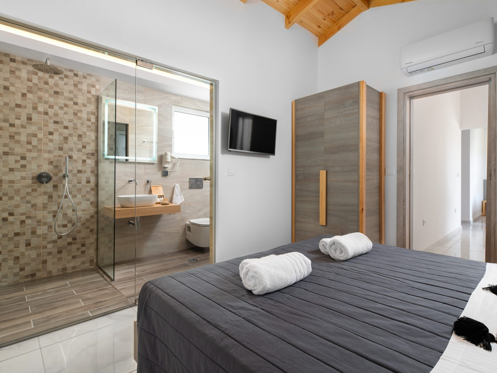 king size bed and en suite bathroom with shower